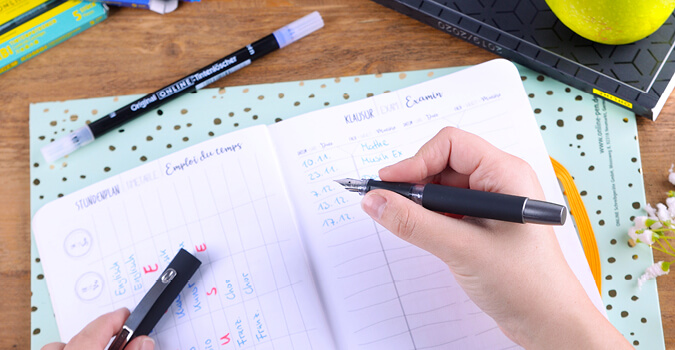 Füller und Hausaufgabenheft
